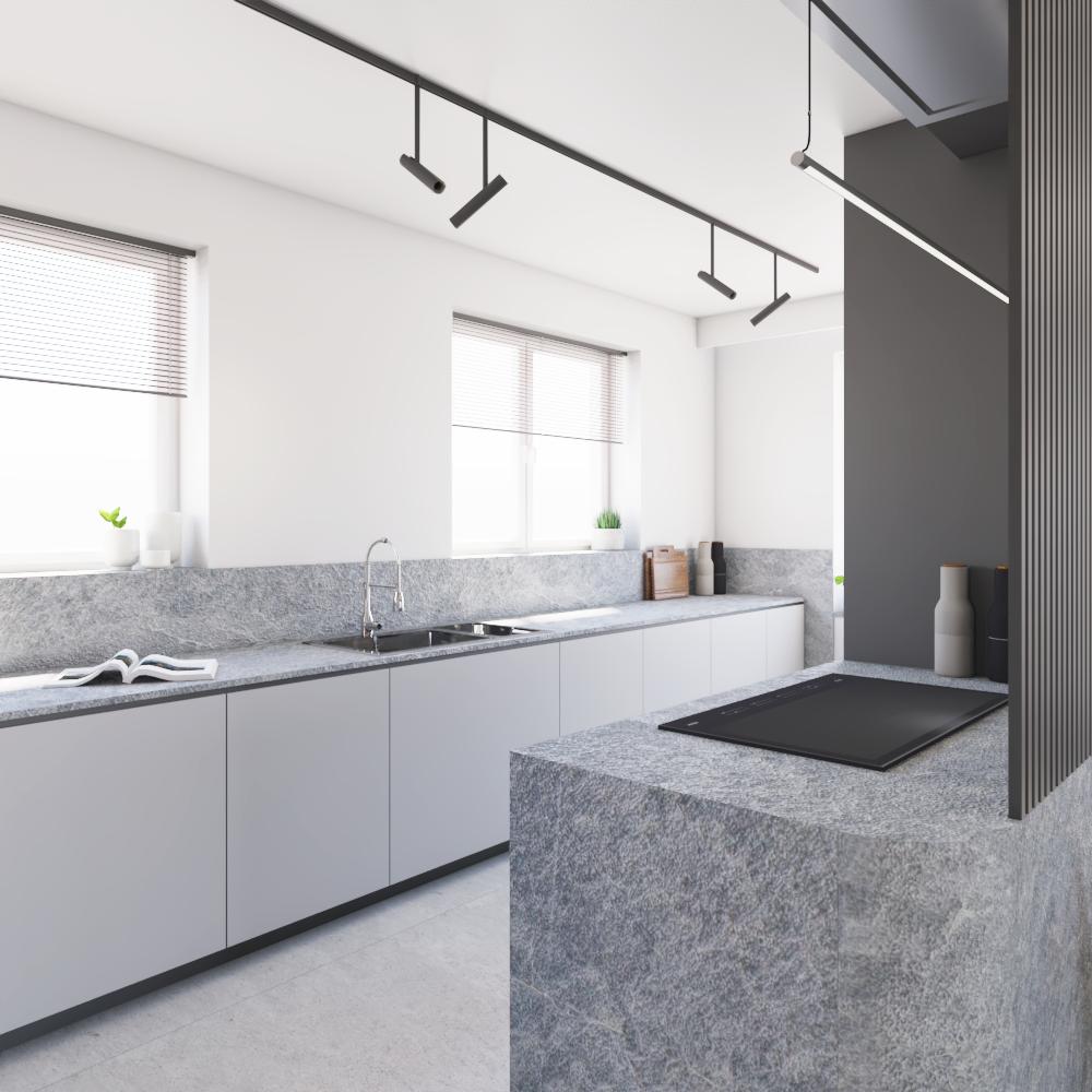 Wyspa kuchenna zCorianu zniewielką ścianką zraszek - pozwala ukryć widok płyty indukcyjnej przezstrefą gości, alezachować efekt wyspy kuchennej.