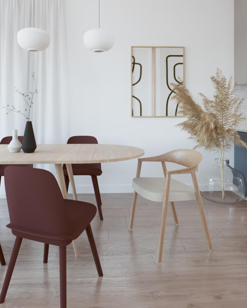 Stół jadalniany zkrzesłami różnokolorowymi, posadzka drewniana