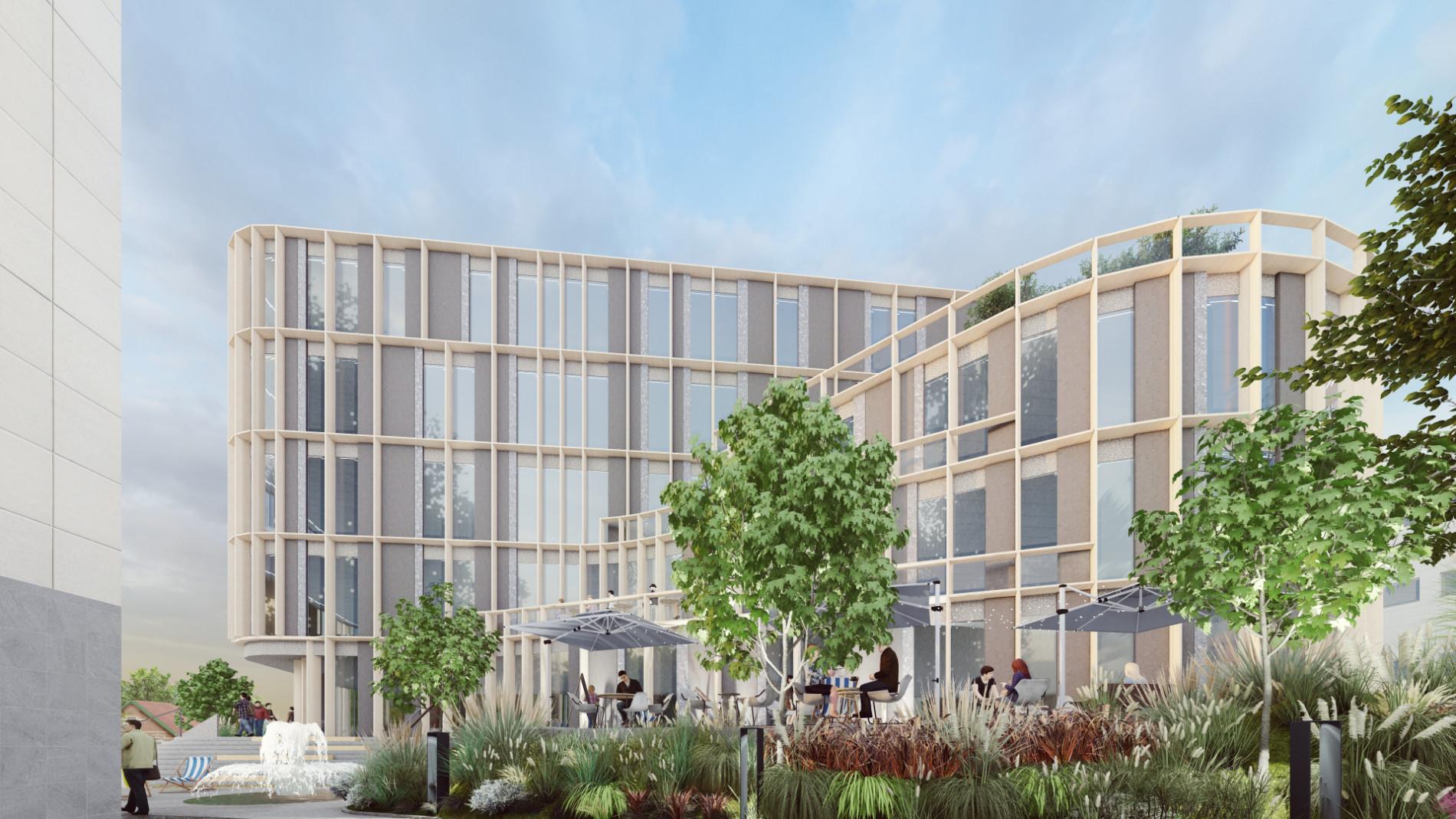 Widok naboczną fasadę budynku biurowego zlokalizowanego wPoznaniu zwidocznym tarasem przeznaczonym dla pracowników biurowych